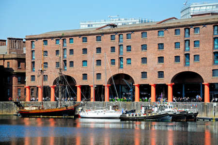 merseyside: Yachts moored in Albert Dock with a pavement cafe to the rear, Liverpool, Merseyside, England, UK, Western Europe.