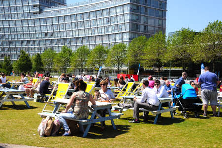 merseyside: People relaxing at picnic benches in Chavasse Park during the Summertime, Liverpool, Merseyside, England, UK, Western Europe. Editorial