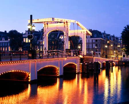 amstel: Magere Brug Skinny Bridge across the River Amstel at dusk, Amsterdam, Holland, Netherlands, Europe.