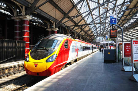 lime: Virgin Class 390 train alongside platform seven in Lime Street Railway Station, Liverpool, Merseyside, England, UK, Western Europe.