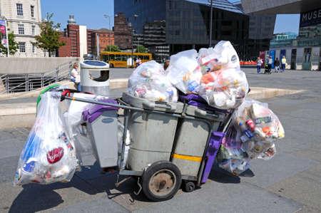 wheelie bin: Trolley with bins full of rubbish at Pier Head, Liverpool, Merseyside, England, UK, Western Europe.