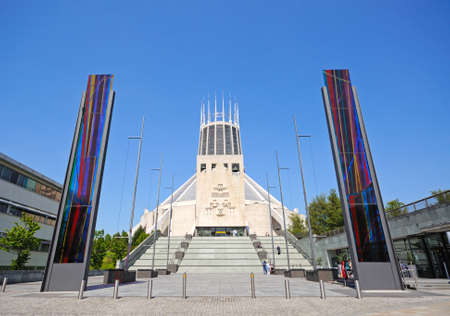 roman catholic: Front view of the Roman Catholic Cathedral with stained glass panels at the base of the steps in the foreground, Liverpool, Merseyside, England, UK, Western Europe. Editorial