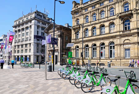 merseyside: Tourist sights signpost in Derby Square on the Corner of James Street with City hire bikes in the foreground, Liverpool, Merseyside, England, UK, Western Europe.