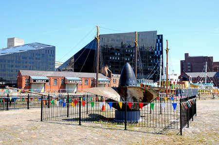 merseyside: Ships propeller and Great Western Railways building at Canning Dock, Liverpool, Merseyside, England, UK, Western Europe.