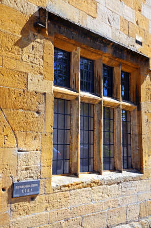 gloucestershire: Window on the facade of the Old Grammar School, Chipping Campden, The Cotswolds, Gloucestershire, England, UK, Western Europe.