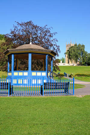 worcestershire: Bandstand in Abbey Gardens with the Abbey clock tower to the rear, Evesham, Worcestershire, England, UK, Western Europe. Stock Photo