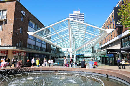 precinct: Lower Precinct Shopping Centre with a fountain in the foreground, Coventry, West Midlands, England, UK, Western Europe.