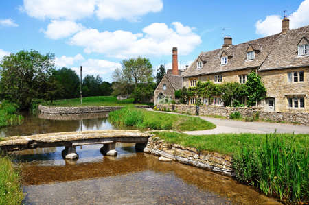 cotswold: Cotswold cottages alongside the river Eye, Lower Slaughter, Cotswolds, Gloucestershire, England, UK, Western Europe. Stock Photo