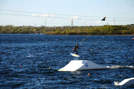 watersport: Man wakeboarding on Chasewater lake, Chasewater County Park, Brownhills, West Midlands, England, UK, Western Europe. Editorial