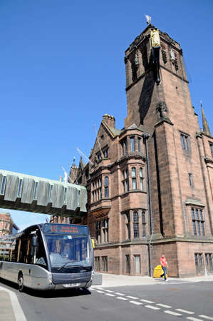 midlands: The Council House and clock tower with a modern bus in the foreground, Coventry, West Midlands, England, UK, Western Europe.
