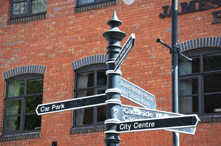 midlands: Signpost in the canal basin pointing towards tourist attractions, Coventry, West Midlands, England, UK, Western Europe. Editorial