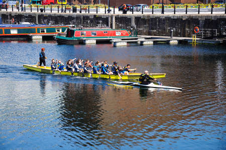 merseyside: Children rowing in Salthouse Dock with narrowboats to the rear, Liverpool, Merseyside, England, UK, Western Europe.