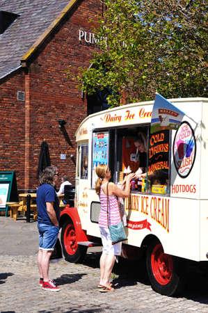 merseyside: Tourists buying ice cream from an ice cream van, Liverpool, Merseyside, England, UK, Western Europe.