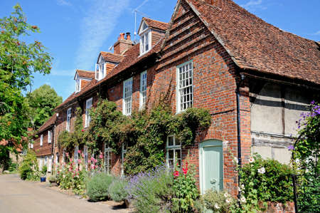 Pretty brick cottages with dormer windows along a village street, Hambledon, Oxfordshire, England, UK, Western Europe.