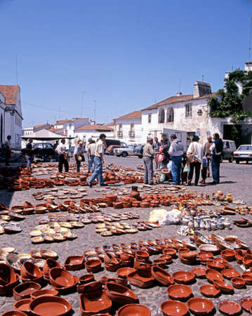 made in portugal: Locally made ceramic plates and dishes for sale at the outdoor market, Evora, Portugal, Europe