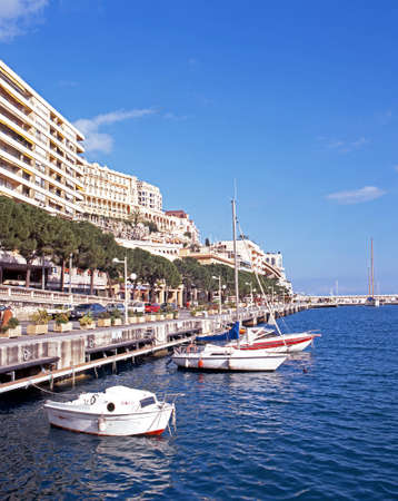 monte carlo: Boats moored in the marina with town buildings to the rear, Monte Carlo, Monaco, Europe