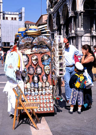 st marks square: People standing by souvenir stall selling glass masks in St Marks Square, Venice, Veneto, Italy, Europe. Editorial