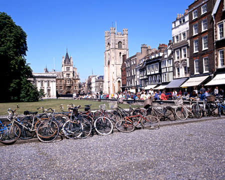 cambridgeshire: Bicycles outside Kings College with the church of St Mary the Great and shops along Kings Parade, Cambridge, Cambridgeshire, England, UK, Western Europe.