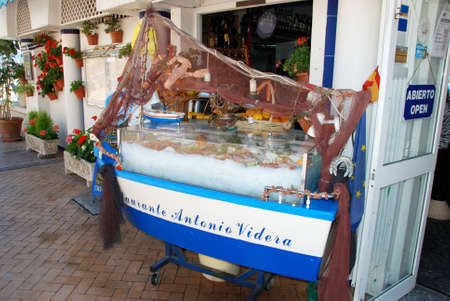 chiller: Fish display cabinet outside a beach bar (Chiringuito), Fuengirola, Malaga Province, Andalusia, Spain, Western Europe. Editorial