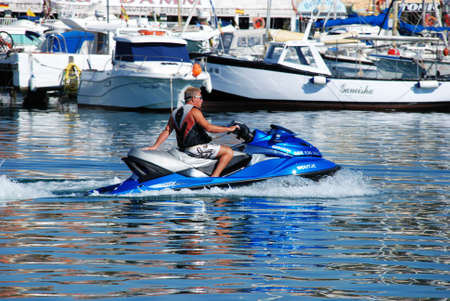 jet skier: Man on a jet ski in the harbour, Fuengirola, Malaga Province, Andalusia, Spain, Western Europe.