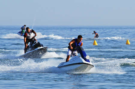 sol: Jet skiers on the sea off the coast of Marbella, Costa del Sol, Malaga Province, Andalusia, Spain, Western Europe. Editorial