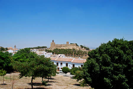 townhouses: Castle fortress with townhouses in the foreground, Antequera, Malaga Province, Andalucia, Spain, Western Europe.