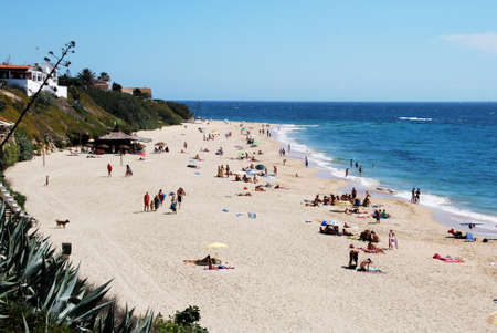 Tourists relaxing on the white sandy beach, Canas de Meca, Costa de la Luz; Cadiz Province, Andalusia, Spain, Western Europe.