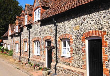 dormer: Pretty brick and flint cottages with dormer windows along a village street, Hambledon, Oxfordshire, England, UK, Western Europe.