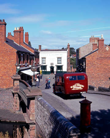 country living: Vintage REO Speedwagon bus along the main Victorian village street at the Black Country Living Museum, Dudley, West Midlands, England, UK, Western Europe.
