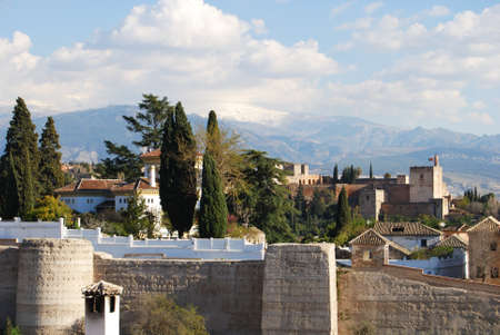 sierra snow: View of the Palace of Alhambra with snow capped mountains of the Sierra Nevada to the rear, Granada, Granada Province, Andalusia, Spain, Western Europe. Editorial