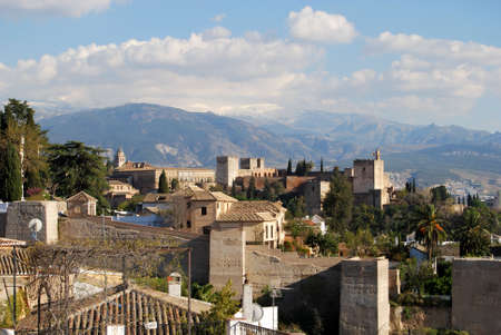castle district: View of the Palace of Alhambra with snow capped mountains of the Sierra Nevada to the rear, Granada, Granada Province, Andalusia, Spain, Western Europe. Editorial