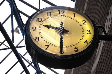 timekeeping: Traditional black round clock.