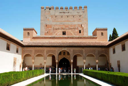 comores: View of the Court of the Myrtles at the Palace of Alhambra Nasrid Palace with the Torre de Comares to rear, Granada, Granada Province, Andalusia, Spain, Western Europe.