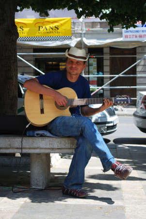 accoustic: Street musician paying a guitar in the Plaza Nueva, Granada, Granada Province, Andalusia, Spain, Western Europe.