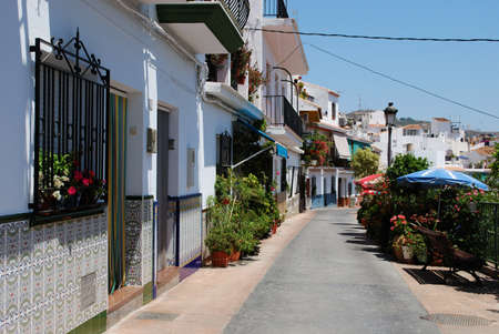 spanish houses: Row of typical Spanish houses with partly tiled walls, Torrox, Costa del Sol, Malaga Province, Andalucia, Spain, Western Europe. Editorial