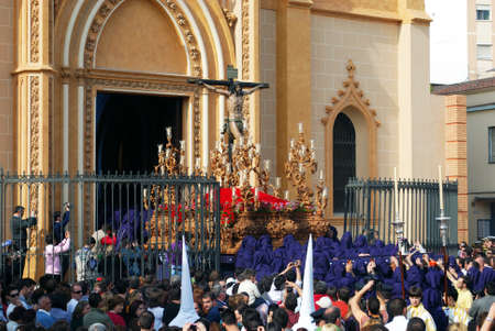 Members of the Salud Brotherhood carrying the float with Christ from the San Pablo (Saint Paul) church during Santa Semana week, Malaga, Malaga Province, Andalusia, Spain, Western Europe. Editorial