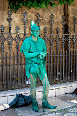 entertainers: Robin Hood living statue outside the Capilla Real, Granada, Granada Province, Andalusia, Spain, Western Europe. Editorial
