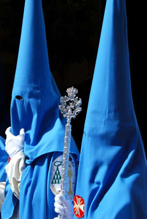 holy week in seville: Members of the San Esteban brotherhood walking through the city streets during Santa Semama, Seville, Seville Province, Andalusia, Spain, Western Europe.