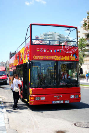 open topped: Red open topped sightseeing tour bus, Benalmadena, Costa del Sol, Malaga Province, Andalusia, Spain, Western Europe.