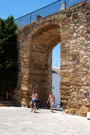 giants: Women walking through the Giants arch (Arco de los Gigantes), Antequera, Malaga Province, Andalucia, Spain, Western Europe. Editorial