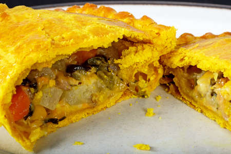 swede: Vegetarian pasty cut in half filled with cheddar cheese, onion, carrot, swede, potato and sweet potato in an all butter pastry flavoured with turmeric.