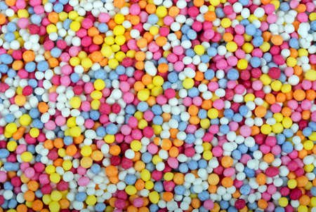 thousands: Hundred and thousands sugar balls food background.