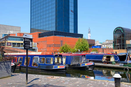 Rear view of the Hyatt Hotel with narrowboats in the foreground at Gas Street Basin, Birmingham, England, UK, Western Europe.