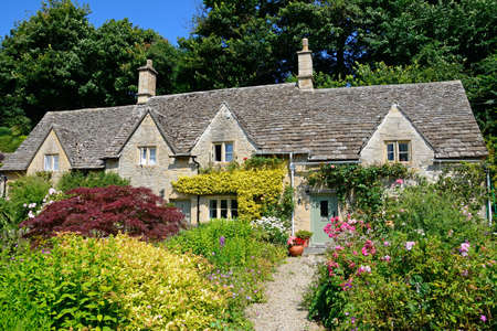 cotswold: Pretty Cotswold cottages and gardens during the Summertime, Bibury, Cotswolds, Gloucestershire, England, UK, Western Europe.