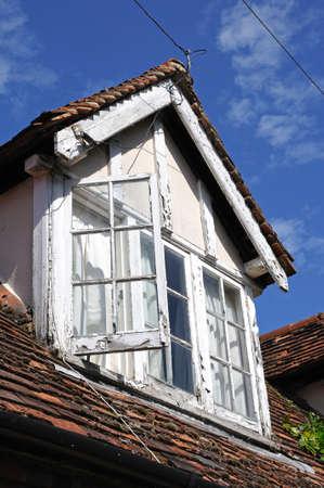 dormer: Rustic dormer window in a village building, Turville, Buckinghamshire, England, UK, Western Europe. Editorial