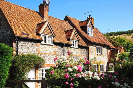 Stone and flint cottage with pretty garden in the village, Turville, Buckinghamshire, England, UK, Western Europe.
