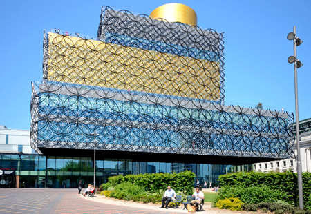 centenary: Front view of the Library of Birmingham in Centenary Square with people sitting on benches in the foreground, Birmingham, England, UK, Western Europe.
