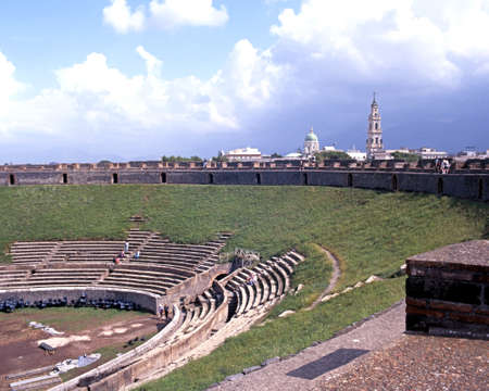 Elevated view of the Roman Theatre ruin with modern buildings to the rear, Pompeii, Campania, Italy, Europe. Editorial