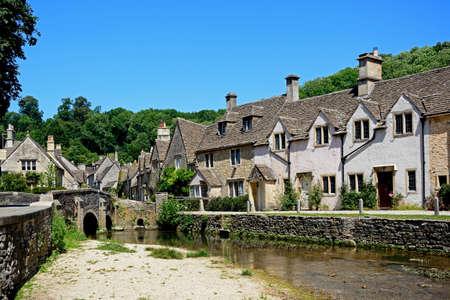 Stone cottages alongside the river Bybrook, Castle Combe, Wiltshire, England, UK, Western Europe.