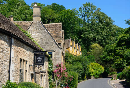 Cotswold stone buildings and part of The Castle Inn in the village centre, Castle Combe, Wiltshire, England, UK, Western Europe.